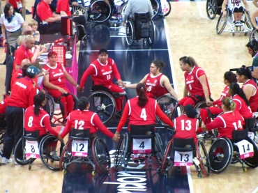 Wheelchair basketball huddle
